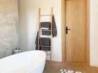 Bathroom textiles on a towel ladder